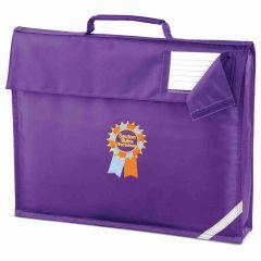 Purple Book Bag with Seaton Sluice First School Logo